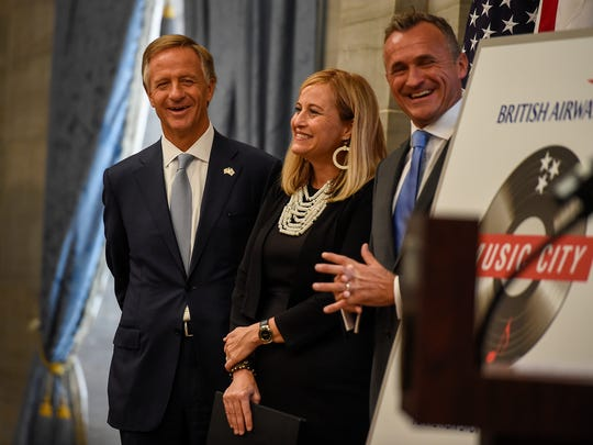 Tennessee Gov. Bill Haslam, Mayor Megan Barry stand with Simon Brooks, senior vice president of North American British Airways, to announce a non-stop flight to London from Nashville at the Tennessee State Capitol in Nashville, Tenn., Tuesday, Aug. 8, 2017.