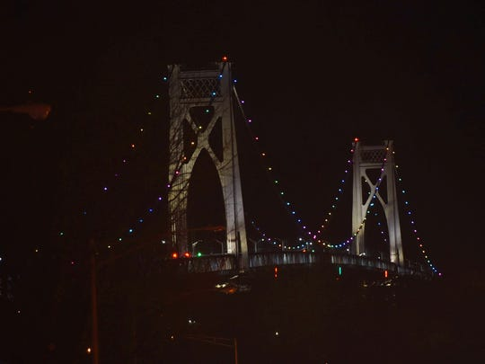 The Mid-Hudson Bridge is illuminated in rainbow colors to honor the passing of City of Poughkeepsie 8th Ward Councilman Tracy Hermann on Thursday.