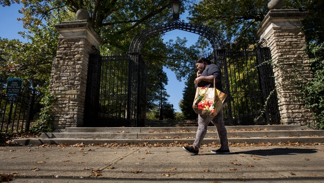 October 20, 2015: A woman walks by Fleischmann Gardens in Avondale.