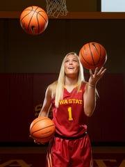 Iowa State's Madison Wise juggles basketballs during