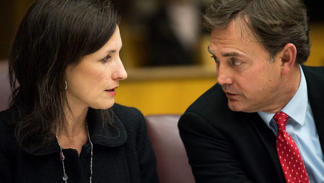 Tara Swafford and Tony Swafford, attorneys for Brentwood Academy, speak during a hearing related to the case at the Williamson County Courthouse in Franklin on Dec. 15, 2017.