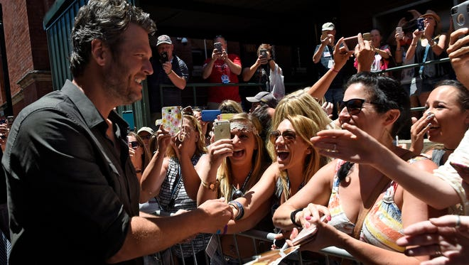 Blake Shelton greets fans in the alley behind The Stage where he performed a surprise shoe for fans Friday June 10, 2016, in Nashville, Tenn.