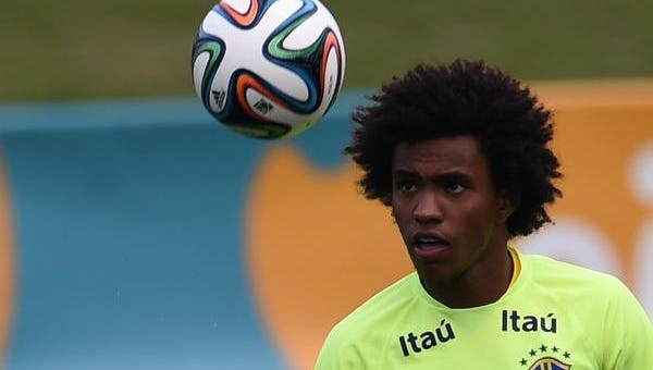 Brazil's Willian controls the ball during World Cup training Sunday in Teresopolis.