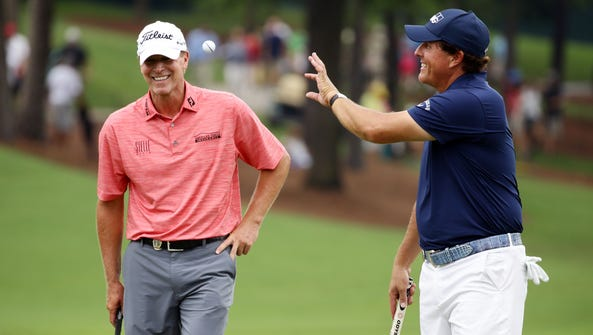 Steve Stricker (left) and Phil Mickelson get in some