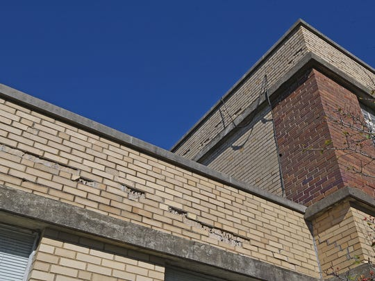 Bricks on the side of Auburn Elementary in Shelby are deteriorating and falling due to moisture damage.