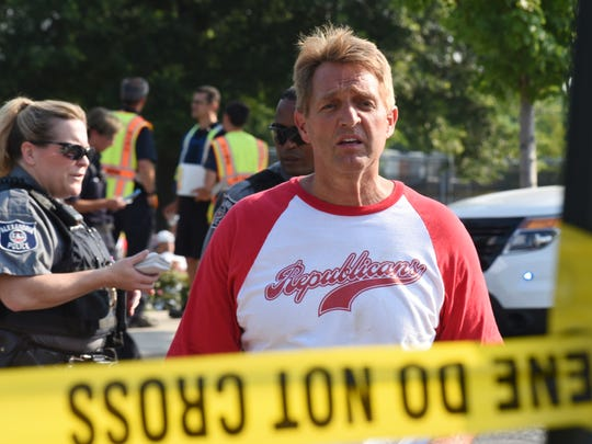 Sen. Jeff Flake walks toward media gathered at the scene of a shooting at a baseball field in Alexandria, Virigina, in June 2017.