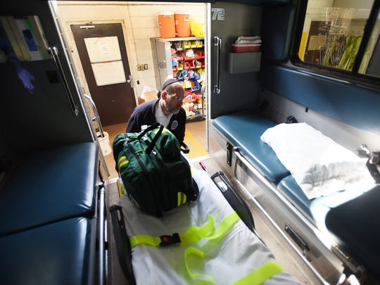 Daniel Senter, former President and Trustee, pulls out a stretcher from an ambulance at Teaneck Ambulance Corp in Teaneck on 04/26/18. Towns across North Jersey are having trouble finding volunteers to fill the ranks of their fire department and ambulance squads.