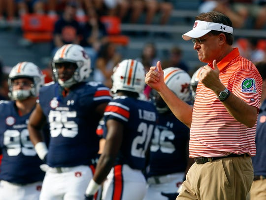 Auburn head coach Gus Malzahn walks around during warmups before an NCAA college football game against Mississippi State, Saturday, Sept. 30, 2017, in Auburn, Ala. (AP Photo/Butch Dill)