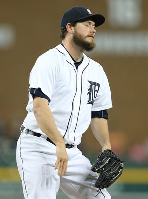 Tigers pitcher Alex Wilson reacts after giving up a two-run, game-tying home run to Royals catcher Salvador Perez in the ninth inning of the Tigers' win in 12 innings Friday at Comerica Park.