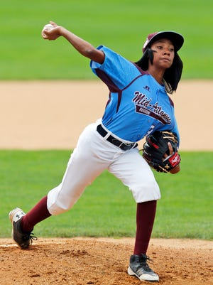 Taney Little League pitcher Mo'ne Davis pitches against the Catskill Mountain Cougars  during an exhibition baseball game at Doubleday Field on Thursday, Sept. 25, 2014, in Cooperstown, N.Y.