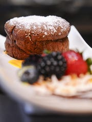 The flourless chocolate souffle with a berry medley served with mango, kiwi and raspberry sauces prepared at Roy's restaurant inside the Hilton Guam Resort & Spa in Tumon.