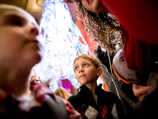 Keagan Mercer, 10, checks out the lobby of New York's Radio City Music Hall with his family before a performance of its Christmas Spectacular on Nov. 25. Keagan's father, Brad Mercer, of Watertown, N.Y., was injured in Afghanistan during an Army deployment.