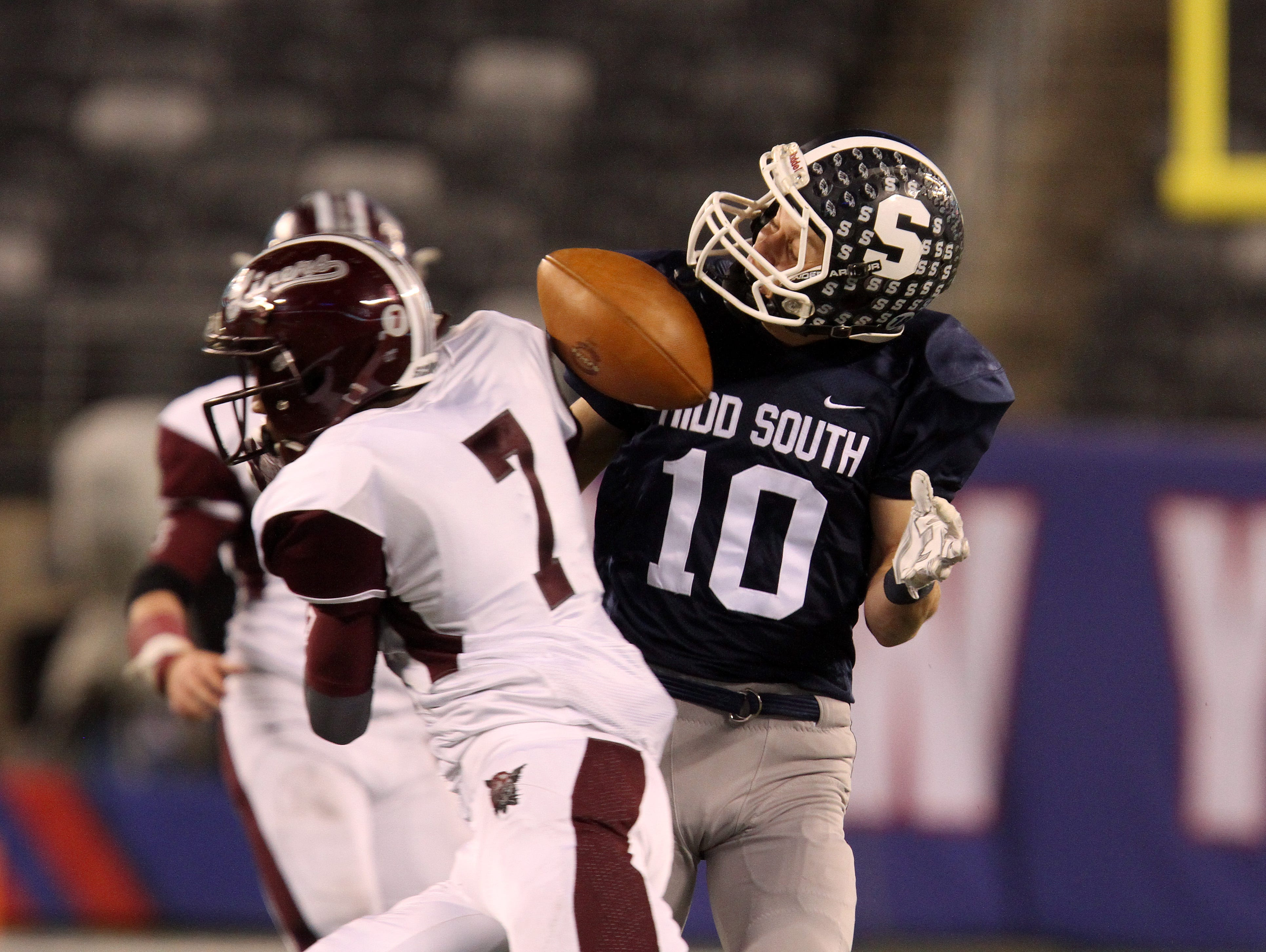 Middletown South's #10 Jeff Lewandowski misses a pass with Phillipsburg High School's #7 Jayshawn Grant challenging him during second half of the North 2 Group IV game of the 2015 NJSIAA/MetLife Stadium High School Football Championships at MetLife Stadium in East Rutherford, NJ Saturday December 5, 2015.