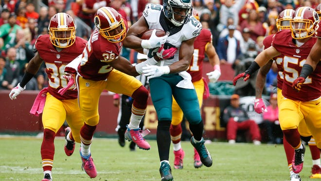 Philadelphia Eagles running back DeMarco Murray (29) is stopped by Washington Redskins cornerback Bashaud Breeland (26) during the first half of an NFL football game in Landover, Md., Sunday, Oct. 4, 2015.