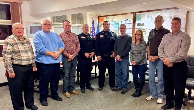 Mishicot's newest police officer, Christopher Brey, was sworn in to office this December. Pictured, from left, are Melvin Kliment, George Krause Jr., John Franz, Chief Paul Granger, Officer Christopher Brey, Village President Bernie Samz, Cheryl Valenta, Rod Scheuer and Don Haack.