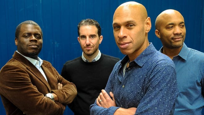 The Joshua Redman Quartet includes the leader (front) on tenor saxophone and (right to left) Reuben Rogers on bass, Aaron Goldberg on piano and Greg Hutchinson on drums