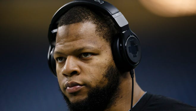 Detroit Lions defensive tackle Ndamukong Suh warms up before a game against the Tampa Bay Buccaneers at Ford Field in Detroit on Sunday, Dec. 7, 2014.