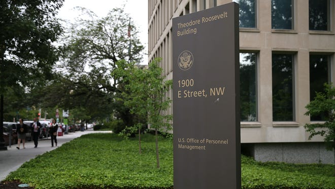 The Theodore Roosevelt Federal Building that houses the Office of Personnel Management headquarters is shown June 5, 2015, in Washington, DC. U.S. investigators have said that at least 4 million current and former federal employees might have had their personal information stolen by hackers.