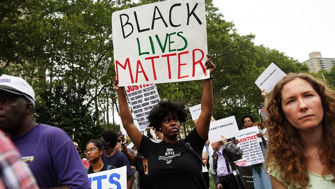People at a rally call for justice for Eric Garner on July 18, 2015, in New York City.