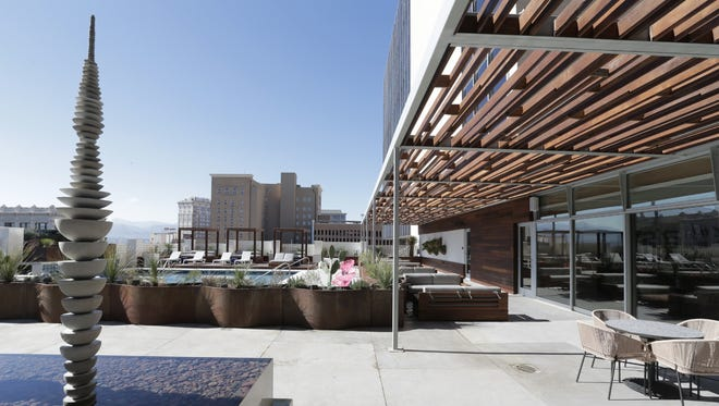 A fountain sculpture, potted cactuses, outdoor sofas and great views of historic buildings make the fifth-story pool area a centerpiece of the new Hotel Indigo in Downtown El Paso.