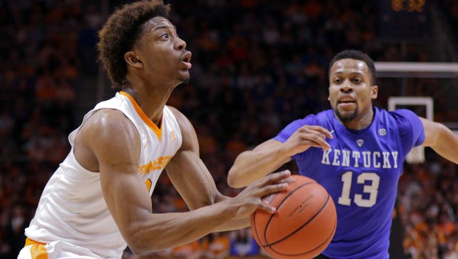 Feb 2, 2016; Knoxville, TN, USA; Tennessee Volunteers guard Robert Hubbs III (3) moves the ball against Kentucky Wildcats guard Isaiah Briscoe (13) during the first half at Thompson-Boling Arena.