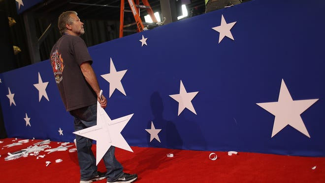 John Sexton places stars on the walls as he helps prepare the Quicken Loans Arena ahead of the Republican National Convention on July 17, 2016 in Cleveland, Ohio.