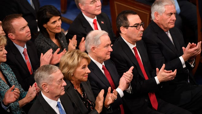 Members of the President's Cabinet react as President Donald Trump addresses a joint session of Congress Feb 28, 2017.