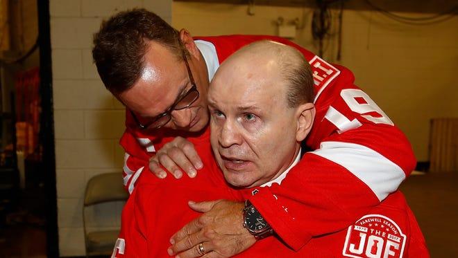 Former Red Wings captain Steve Yzerman and defenseman Vladimir Konstantinov embrace after a ceremony honoring Joe Louis Arena on April 9, 2017.