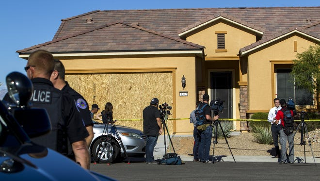Law enforcement and members of the media gathered outside Stephen Paddock's home on Oct. 2, 2017, in Mesquite, Nevada. Investigators say Paddock fired into a crowd of people at a concert from his hotel room at Mandalay Bay in Las Vegas on Sunday night, killing at least 59 people and injuring more than 500.