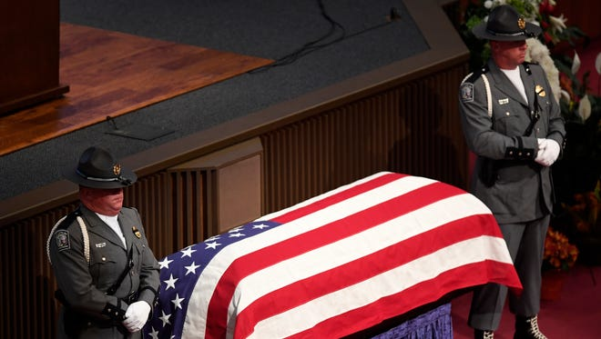South Carolina Highway Patrol troopers stand beside Trooper Daniel K. Rebman Jr's casket, blanketed in an American flag before his funeral service at Bob Jones University on Sunday, Oct. 29, 2017.
