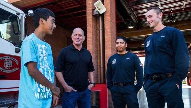 Eric Mendez, 14, talks with Ryan Mingis, Hector Lopez, and Blake Tirman on Dec. 6, 2017 at Fire Station 5 in Phoenix. Mendez, who received an accidental gunshot wound to the chest in 2016, met the first responders and doctors for the first time since his injury.