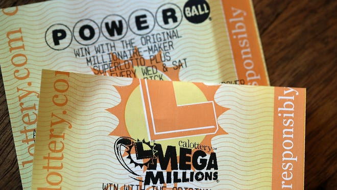 Powerball and Mega Millions lottery tickets are displayed on Jan. 3, 2018, in San Anselmo, Calif. For the first time the Powerball  and Mega Millions jackpots are both more than $400 million.