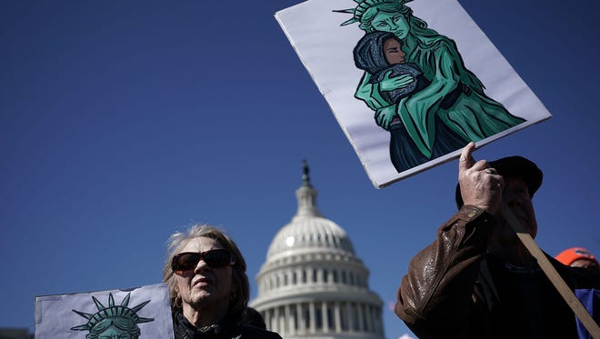 Immigration activists pushing for Congress to save the Deferred Action for Childhood Arrivals program hold signs during a protest March 5, 2018, on Capitol Hill in Washington, D.C.