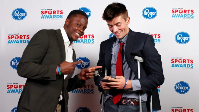 Teddy Bridgewater jokes with Michael Hagerty, winner of the Boys Soccer Player of the Year award, during the 2018 Courier Journal Sports Awards held at The Louisville Palace in downtown Louisville. June 7, 2018