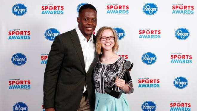 Teddy Bridgewater poses with Emmaline Kleinman, winner of the Archer of the Year award, during the 2018 Courier Journal Sports Awards held at The Louisville Palace in downtown Louisville. June 7, 2018