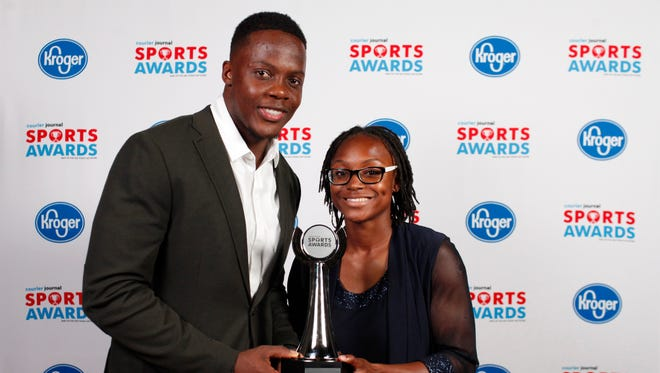 Teddy Bridgewater poses with Aa'Leiah Winford, winner of the Indiana Girls Athlete of the Year award, during the 2018 Courier Journal Sports Awards held at The Louisville Palace in downtown Louisville. June 7, 2018