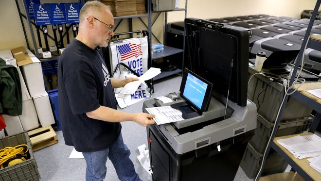 Certified Municipal Clerk Thomas Lund heads up a public test of election equipment in Madison, ahead of the Aug. 14 primary. A group of paid staff and volunteers test all the voting machines by running ballots with all voting scenarios for that ballot, and for each candidate, through the machines and making sure they tally them correctly. The machines are not connected to the internet, but send the results via a one-way modem to the county clerk's office. A scanned version of each ballot is stored on a USB memory card. The testing, open to the public, took place Aug. 6.