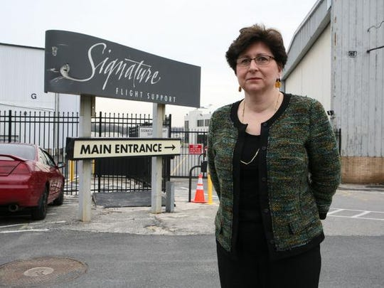 Westchester County Legislator MaryJane Shimsky, stands outside the gate of Signature Flight Services at the Westchester County Airport, April 2, 2014. Signature Flight Services agreed to an extended lease at the airport.