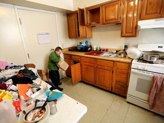 Arthur Murray unpacks his go-pack in the family's kitchen and quickly dives into the fruit snacks.