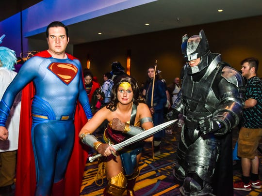 Jeremy Lester, 36, of Des Moines, Rochelle Lester, 27, of Des Moines and Frederic Perras, 27, of Ames show off their costumes at the Wizard World Comic Con 2016 at the Iowa Events Center on May 14, 2016.