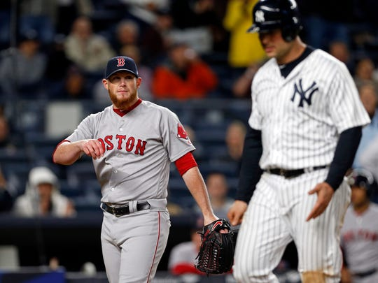 Red Sox relief pitcher Craig Kimbrel (46) looks over at New York Yankees designated hitter Matt Holliday (17) who scored on a wild pitch by Kimbrel during the eighth inning at Yankee Stadium on Tuesday, June 6, 2017.