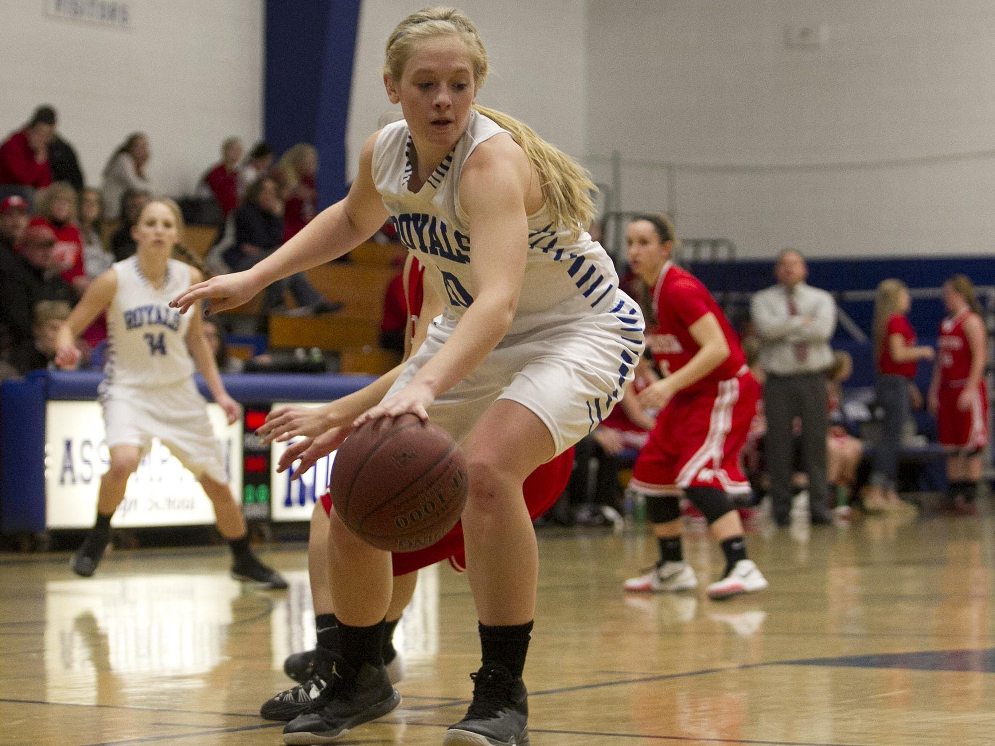 Assumption's Macyn Krings dribbles the ball Tuesday during the first half of a Marawood Conference girls basketball game at Assumption High School in Wisconsin Rapids.