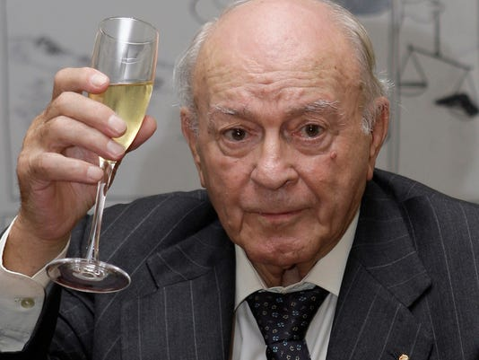 """FILE- In this  Friday Nov. 13, 2009 file photo, former soccer player and honorary president of Real Madrid Alfredo Di Stefano, raises his glass during a homage for his contribution to sport at the Argentine Embassy in Madrid. Football great Alfredo Di Stefano was in """"critical"""" condition in a hospital after a heart attack, his Real Madrid club said on Saturday, July 5, 2014. Di Stefano was in """"critical, serious"""" condition at Madrid's Gregorio Maranon Hospital, club spokeswoman Marta Santisteban told The Associated Press. Di Stefano is a former Argentina star who helped Madrid win five straight European Champions Cups, and was voted European player of the year in 1957 and '59. He is 88 years old. (AP Photo/Paul White, file)"""