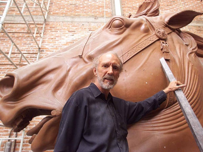 El Paso sculptor John Houser stands by the horse head