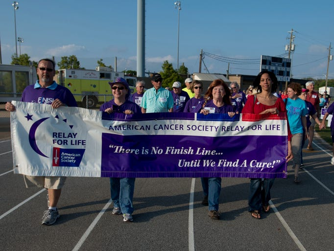 Cancer Survivors, their family members, friends and their supporter help kick-off the Beach Breeze Relay for Life at the Gulf Breeze High School stadium Friday morning. This yearâ??s event was a combined effort between the Pensacola Beach and Gulf Breeze chapters of Relay for Life.