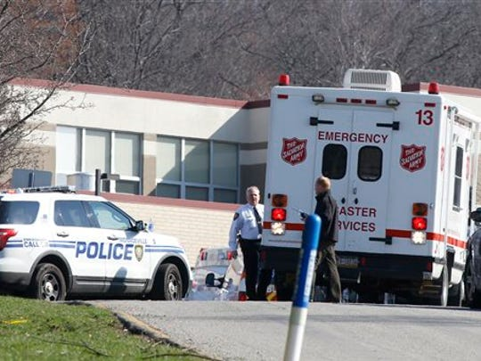 Emergency responders gather in the parking lot of the high school on the campus of the Franklin Regional School District where several people were stabbed at Franklin Regional High School on Wednesday, April 9, 2014, in Murrysville, Pa., near Pittsburgh. The suspect, a male student, was taken into custody and being questioned. (AP Photo/Keith Srakocic)