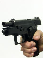 The 9mm Sig Sauer handgun in this 1999 Free Press file.