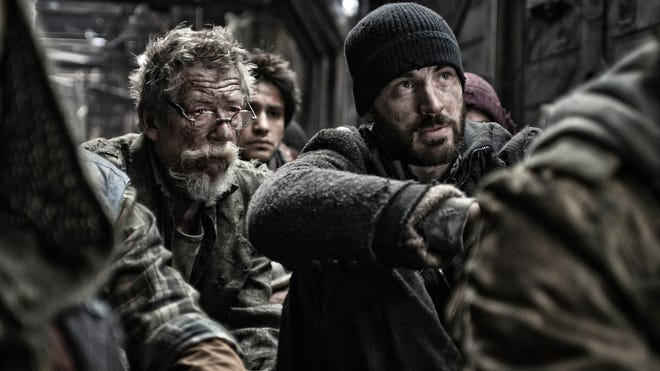 """John Hurt and Chris Evans in a scene from the motion picture """"Snowpiercer."""""""