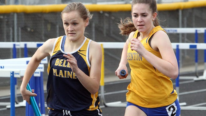 Belle Plaine's Emma Willett and Madelyn Schadle race in the last leg of the 4x800 of the Bobcat Co-ed.