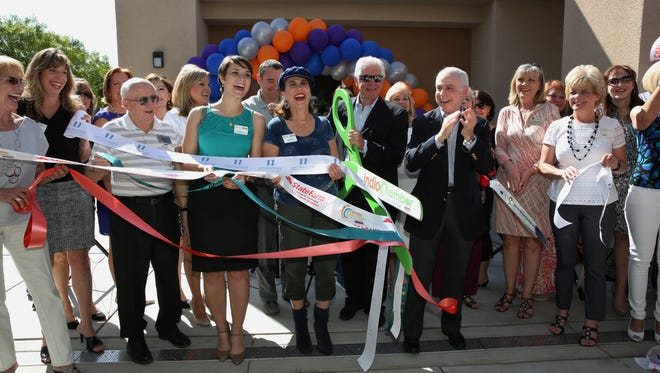 Richard Balocco, Desert Arc president and CEO and Mitch Blumberg, Desert Arc senior vice president, cut the ribbons of six desert chambers of commerce as they dedicated a new building on the organization's Palm Desert campus. Chambers included Palm Springs, Palm Desert, Rancho Mirage, La Quinta, Indio and Coachella.